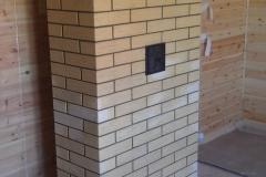 Железная угловая печь-камин с подключаемым отопительным щитом на 2 этаже